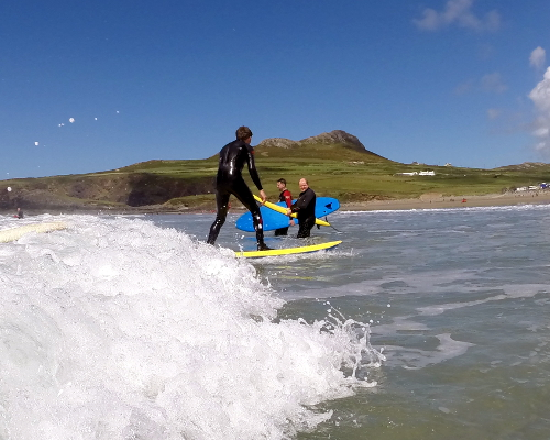 Catching first wave Surfing lesson