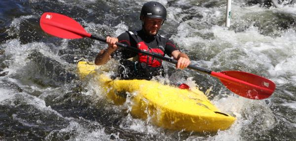 Kayaking down rapids